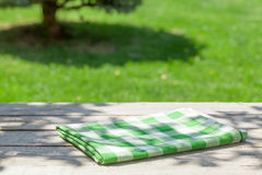 Empty wooden garden table with tablecloth Stock Photography