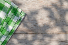 Empty wooden garden table with tablecloth Stock Photo
