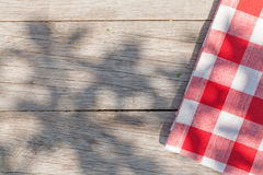 Empty wooden garden table with tablecloth Royalty Free Stock Photos