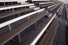 Empty Wooden Grandstand. Old Fashioned wooden grandstand, abandoned and empty and waiting for your event to fill royalty free stock image