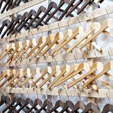 Empty wooden hangers. In the store Stock Images