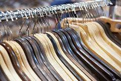 Empty wooden hangers. In the store Royalty Free Stock Photo