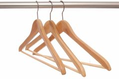 Empty wooden hangers Royalty Free Stock Photos
