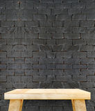 Empty wooden modern table on brick tiles wall,Mock up for displa Stock Photos