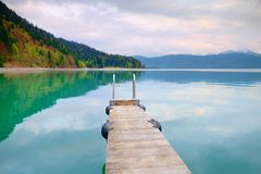 Empty wooden mole on  blue Alps lake, wharf for hired boats Stock Photo