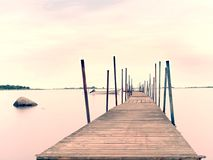 Free Empty Wooden Mole In Water Of Blue Lake. Old Fishing Wharf For Hired Boats And Swimmers. Royalty Free Stock Images - 107793599