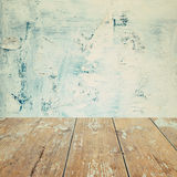 Empty wooden old table over painted grunge wall background Royalty Free Stock Photo