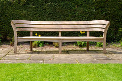Empty wooden park bench Royalty Free Stock Photos