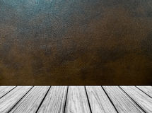 Empty Wooden Perspective Platform with Dark Brown Leather Background Texture in Vintage Style Room Interior Royalty Free Stock Images