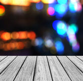 Empty Wooden Perspective Platform with Sparkling Abstract Rainbow Blur Bokeh used as Template to Mock up for Display Product Royalty Free Stock Images