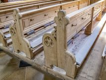 Empty wooden pews in St. John the Baptist Church in Oberstdorf, Germany stock image