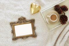 Empty wooden photo frame over cozy and warm fur carpet. For photography montage. Top view. Royalty Free Stock Photo