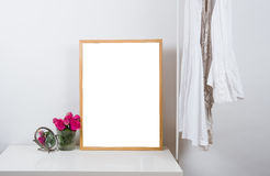 Empty wooden picture frame on the table, art print mock-up Stock Image