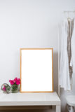 Empty wooden picture frame on the table, art print mock-up Royalty Free Stock Photos