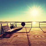 Empty wooden pier at beautiful colorful morning. Tourist wharf in sea bay. Stock Image
