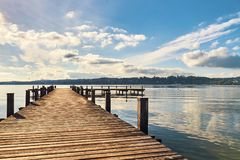 Empty wooden pier on Lake Starnberg. In Bavaria, Germany Royalty Free Stock Images