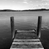 An empty wooden pier New Zealand Stock Photos