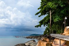 Empty wooden pier on tropical island Stock Image