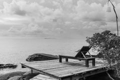 Empty wooden pier on tropical island Stock Images