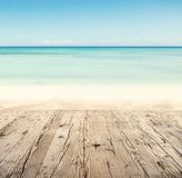 Empty wooden pier with view on sandy beach. Free space for text or product placement Stock Photos