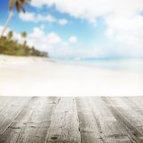 Empty wooden pier with view on sandy beach. Free space for text or product placement Stock Photography
