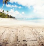 Empty wooden pier with view on sandy beach. Free space for text or product placement Stock Image