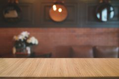 Empty wooden plank with blurred cafe bar background.  royalty free stock photos