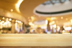 Empty wooden plank with blurred shopping mall background.  stock image