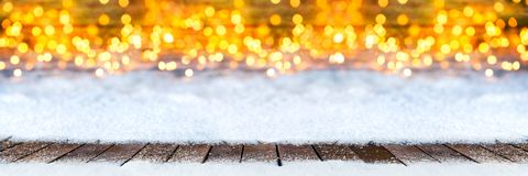 Empty wooden planks floor on christmas snow lights bokeh warm ba royalty free stock images