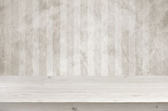 Empty wooden planks table top over grunge wall background