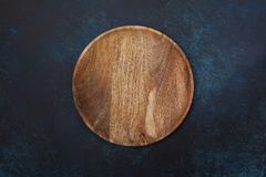 Empty wooden plate Stock Image
