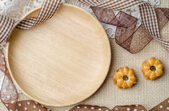 Empty wooden plate with coconut biscuit and pineapple jam Royalty Free Stock Photo