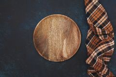 Empty wooden plate. And napkin on a blue background. view from above Royalty Free Stock Images