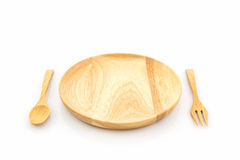 Empty wooden plate and spoons, forks. Stock Photos