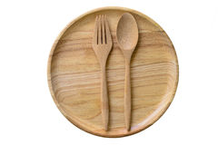 Empty wooden plate and spoons and forks. Empty wooden plate and spoons, forks on white background, Set of wooden plate and spoons, forks Royalty Free Stock Photo