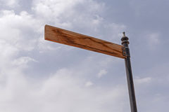 Empty wooden pointer. On pole against sky Royalty Free Stock Image
