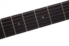 Empty wooden rosewood fingerboard electric guitar. Empty wooden rosewood fingerboard of classic electric guitar closeup. Six strings free frets and fretboard Stock Photo