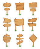 Empty wooden round and square signpost standing in grass. Vector illustration set Stock Photos