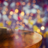 Empty wooden round table over bokeh lights beautiful background Stock Photos