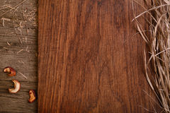 Empty wooden rustic cutting board with straw copy space for text Stock Photo