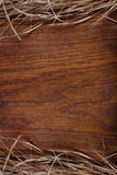 Empty wooden rustic cutting board with straw copy space for text Royalty Free Stock Photography