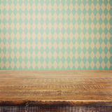 Empty wooden rustic table over Bavarian pattern wallpaper. Oktoberfest beer festival Royalty Free Stock Images