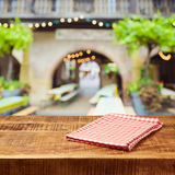 Empty wooden rustic table with tablecloth over festive market bokeh background. Empty wooden rustic table with tablecloth over festive market bokeh Royalty Free Stock Photo