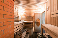 Empty wooden sauna room with ladle, bucket ready to be used royalty free stock photo