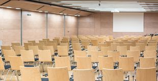 Empty wooden seats in a cotmporary lecture hall. stock photos
