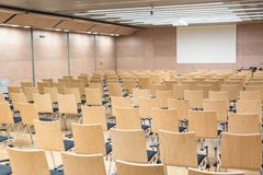 Empty wooden seats in a cotmporary lecture hall. stock images