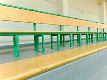 Empty wooden seats in a sports stadium.  Tribune for fans of matches with benches. Royalty Free Stock Photos