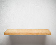 Empty wooden shelf or bookshelf on white wall. Empty wooden shelf on white wall Royalty Free Stock Photography