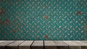 Empty wooden shelf display on metal wall. Sheet Stock Image