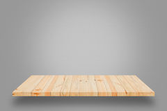 Empty wooden shelf on grey gradient background. Empty wooden shelf on grey gradient wall background. For display or montage your products stock image